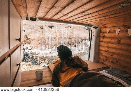 Vanlife - Young Woman Lying In Camping Van And Looking At Beautiful Nature