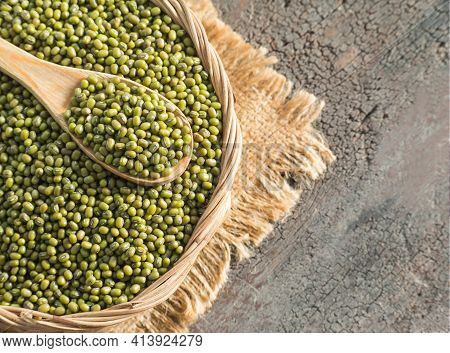 Mung Bean On Wooden Ladle In Wicker Basket With Blur Image Of Wood Background. Healthcare Food Conce
