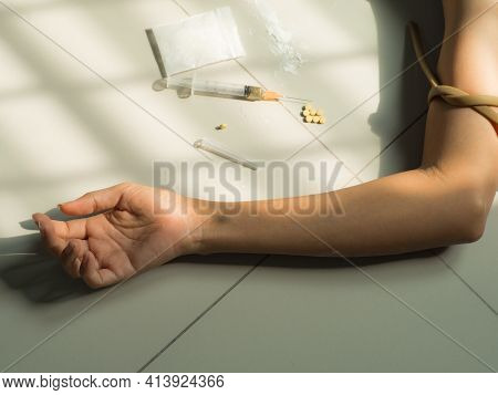 Heroin, Injection Needle With Hand Asian Women. Heroin Is Hard Drugs. Narcotic Recreational Drugs Co