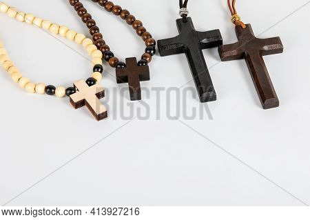 Wooden Cross On A White Background. Religion, Belief And Faith
