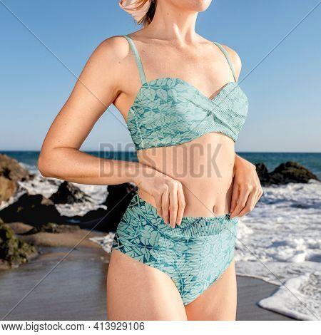 Blonde woman in blue bikini at the beach portrait
