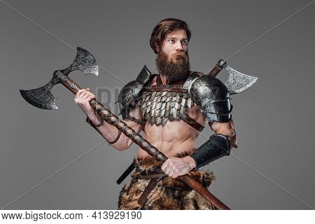 Stationary Muscular Viking With Double Axe And Hatchet On His Back