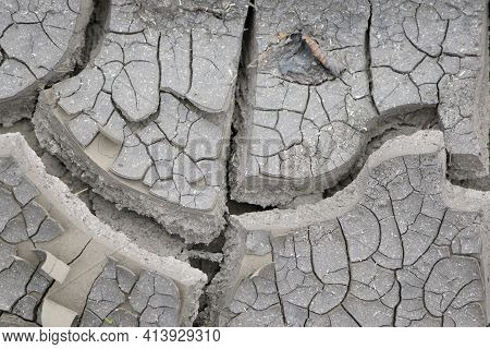 Background Of Cracks In The Soil Drought Ecology. Dry Cracked Ground Texture. Desert Background. Glo