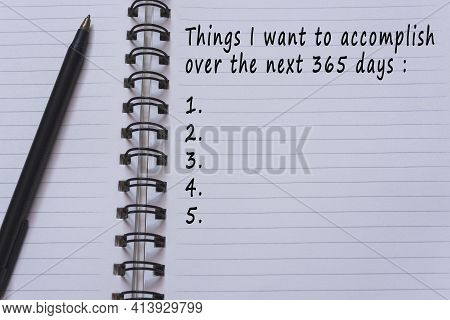 Text On Notepad With Pen - Things I Want To Accomplish Over The Next 365 Days