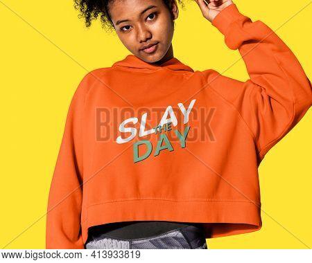 Girl in an orange hoodie winter youth apparel shoot