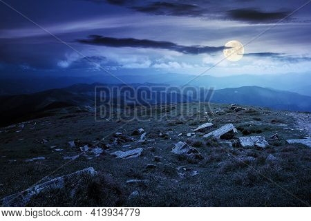 Carpathian Summer Mountain Landscape At Night. Beautiful Countryside With Rocks On The Grassy Hill I