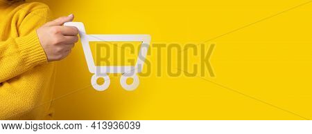 Shopping Cart In Hand Over Yellow Background, Panoramic Mock-up