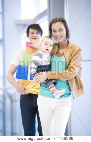 Young Couple Shopping With A Baby