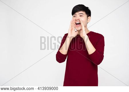 Portrait Of Excited Screaming Young Asian Man Isolated Over White Background, Wow And Surprised Conc