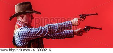 West, Guns. Portrait Of A Cowboy. Western Man With Hat. Portrait Of Cowboy In Hat. Man Wearing Cowbo