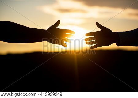 Friendly Handshake, Friends Greeting, Teamwork, Friendship. Rescue, Helping Gesture Or Hands. Outstr