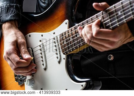 Man Playing Guitar. Close Up Hand Playing Guitar. Musician Playing Guitar, Live Music. Musical Instr