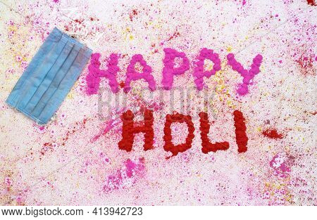 Medical Face Mask With Happy Holi Wish Written With Gulal Or Holi Colors On White Background, Holi F