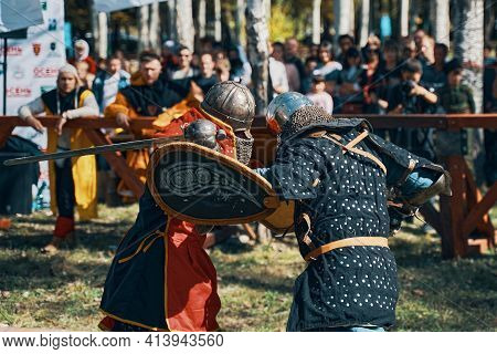 Sword Fighting. Shield With The Emblem Of The Historical Club. Festival Of Medieval Culture In The P