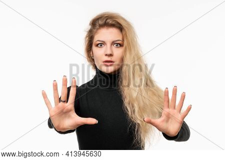 Close Up Blonde Girl Feeling Stupefied And Scared, Fearing Something Frightening, With Hands Open Up