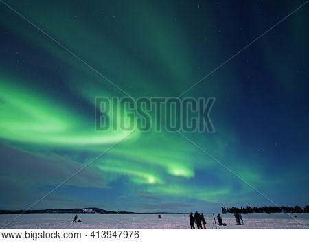 Aurora Borealis Or Northern Lights Over Lake Inari