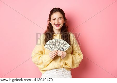 Young Happy Millennial Girl Showing Dollar Bills, Holding Money With Pleased Face, Winning Cash Priz