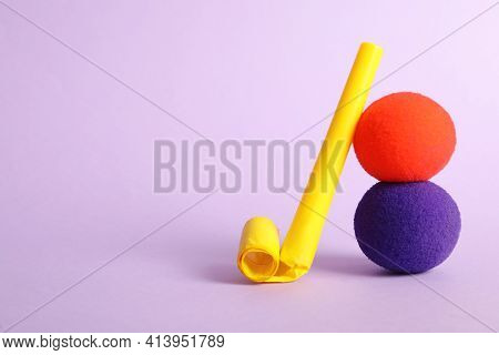Clown Noses And Party Blower On Violet Background, Space For Text