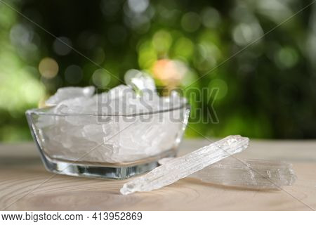Menthol Crystals On Wooden Table Against Blurred Background. Space For Text