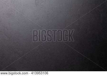 Dark grey stone background. Black slate texture. Wall or floor natural surface