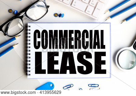 Commercial Lease. Business Concept. Text On White Notepad Paper On Light Background.