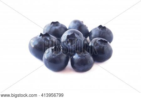 Blueberries Isolation. Ripe Blueberries With Copy Space For Text. Heap Of Blueberry Isolated On Whit