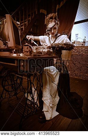 Beautiful steampunk lady scientist inventor repairs the mechanism in her laboratory with Victorian interior. Art portrait in sepia color.