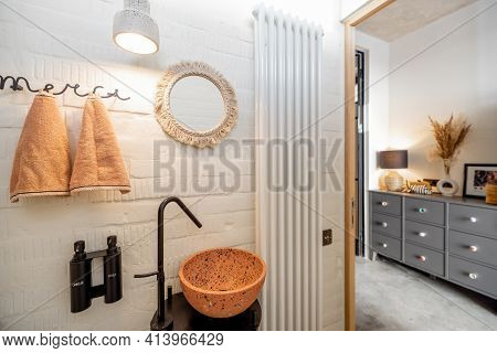 Stylish Guest Toilet Interior With Terazzo Sink