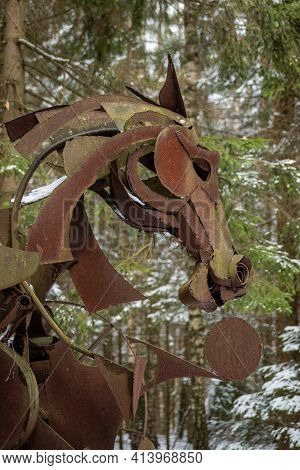 Vilnius, Lithuania - March 19 2021: Creepy Horse Face In A Wood, Rusted Iron Sculpture, Vertical