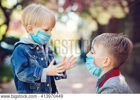 Children Wearing Face Mask During Corona Virus Outbreak. Covid-19 Quarantine And Lockdown. Family Wa