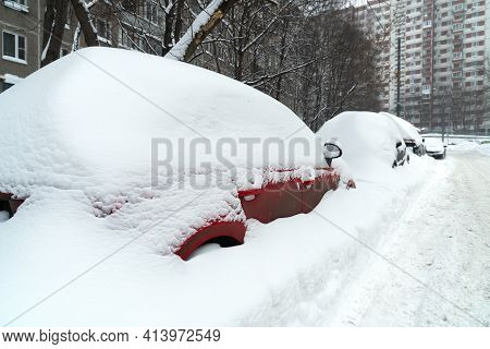 Cars Covered With Snow After A Hard Blizzard