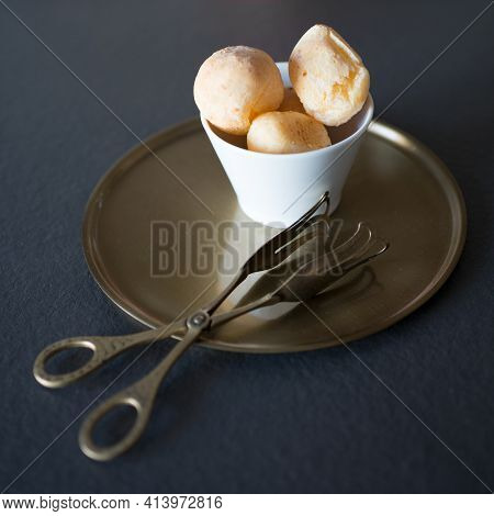 Delicious Bite Dessert Filled With Cream. Set In A White Bowl On An Antique Bronze Tray. Beautiful B