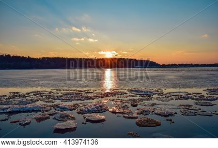 Ice Drift On Dnieper River In Cherkasy City, Ukraine During Sunset