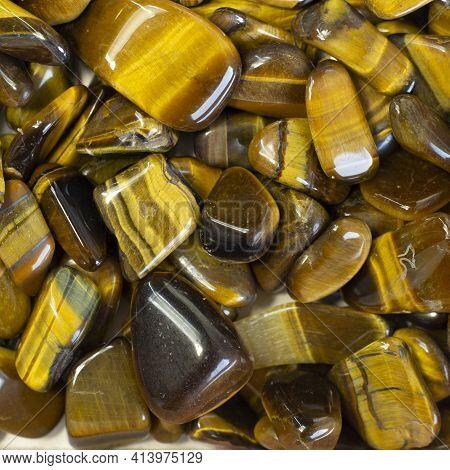 Natural Mineral Gem Stone Tiger's Eye Tigers Eye, Tiger Eye Gemstoneon On Light Beige Background Clo