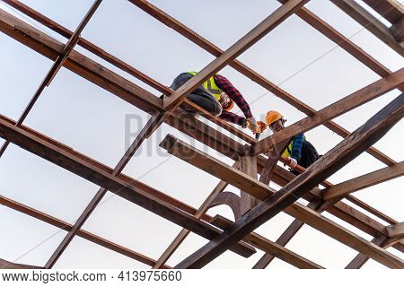 Two Asian Construction Worker Install New Roof, Roofing Tools, Electric Drill Used On New Roofs Of W
