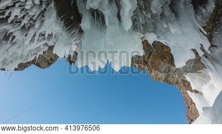 The Ceiling Of The Stone Grotto Is Covered With Bizarre Icicles That Look Like Stalactites. Close-up