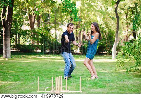 Friends Plaing Outdoor Games - Ring Toss In Summer Park.