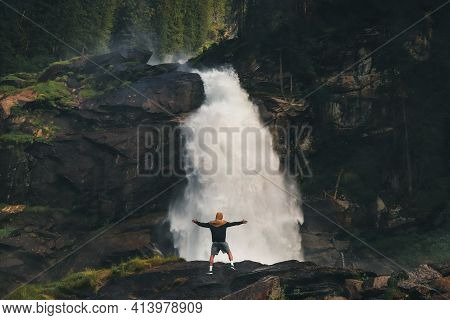 Enormous Power Of The Lower Stage Krimml Waterfalls, Which Shows The Power Of Water. A Man Stands On