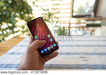 Holding A Mobile Phone With Several Applications