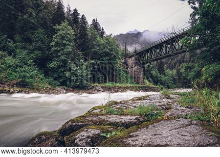 Ancient Green Railway Bridge Over Wild River Enns In Rainy Weather In Gesause National Park Near Tow
