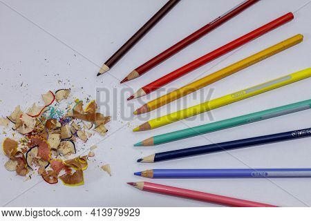 Tempered Colored Pencils On A White Background
