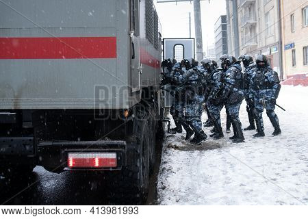 Moscow, Russia - January 31, 2021: Russian Riot Police Officers Enter The Police Bus On Unauthorized