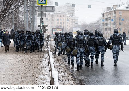 Moscow, Russia - January 31, 2021: Russian Riot Police Officers Going Along A Roadway During An Poli