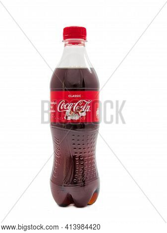 Gomel, Belarus - March 24, 2021: Carbonated Soft Drink In A Plastic Bottle On A White Background Coc