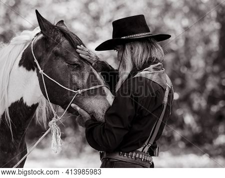 Cowboy Touches The Horse With Love Because Of Relationships That Are Friends Who Share Suffering And