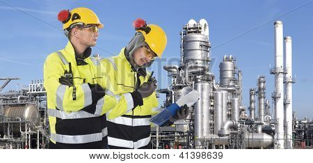 Two industrial guards checking the safety around the site,