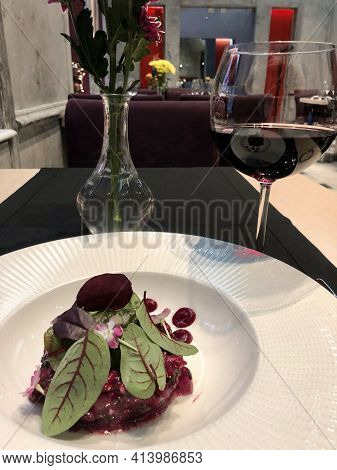 Tartar Of Fresh Tuna With Traditional Garnishes, Accompanied By Red Wine In 2 Mazi Restaurant In Ath