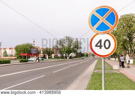 The Sign Of The Maximum Speed Limit And Sign Prohibiting The Stop On City Background. Forty Kilomete