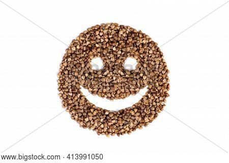 Funny Smile Icon. An Isolated Face With Eyes And A Smile Is Made From Raw Buckwheat. Funny Face Made