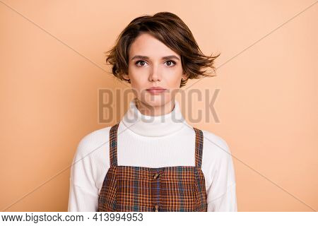 Photo Portrait Of Serious Calm Girl With Bob Hairstyle Isolated On Pastel Beige Color Background